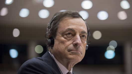European Central Bank's (ECB) president Mario Draghi looks on during a debate on ECB's activities at the EU parliament in Brussels