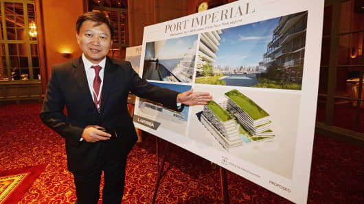Chinese property tycoon Tian Ming shows one of his new New York developments at the Biltmore Hotel in Los Angeles.