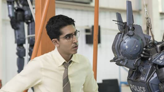 """Actor Devin Patel, who plays Deon in """"Chappie,"""" is featured with his creation."""