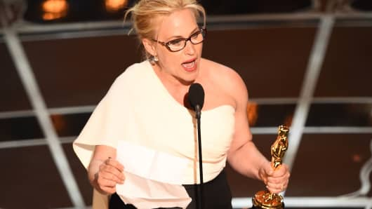Patricia Arquette accepts her award for Best Supporting Actress at the 87th Oscars February 22, 2015 in Hollywood, California.