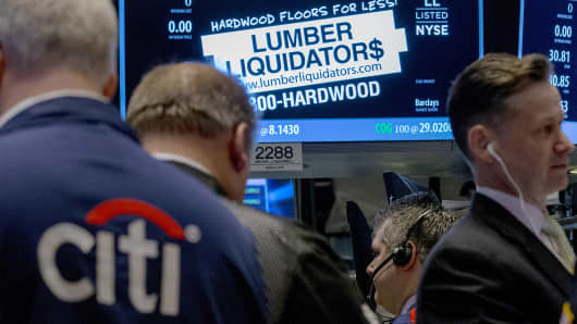 A file photo showing traders waiting for shares of Lumber Liquidators to begin trading on the floor of the New York Stock Exchange.
