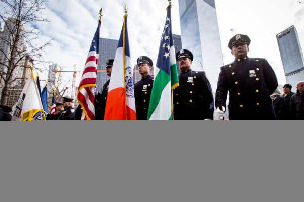 A NYPD Police honor guard stands at attention during a ceremony
