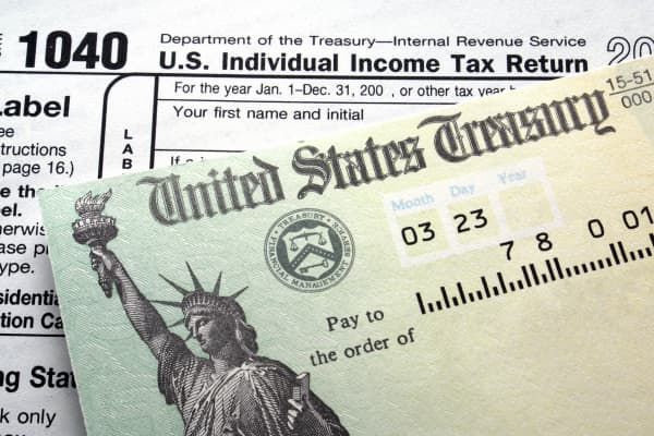 Treasury check and 1040 tax form