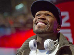 50 Cent with headphones around neck