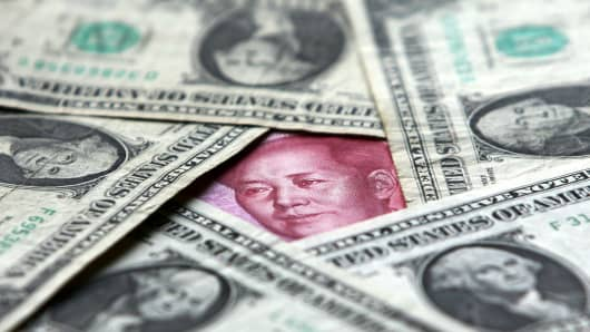 OCBC predicts a weaker CNY against the USD by year-end.