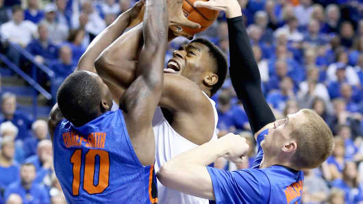Dakari Johnson of the Kentucky Wildcats gets stopped by the Florida Gators on March 7, 2015 in Lexington, Kentucky.