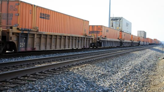 A train from Kansas City Southern sits on the track ready to ship containers.