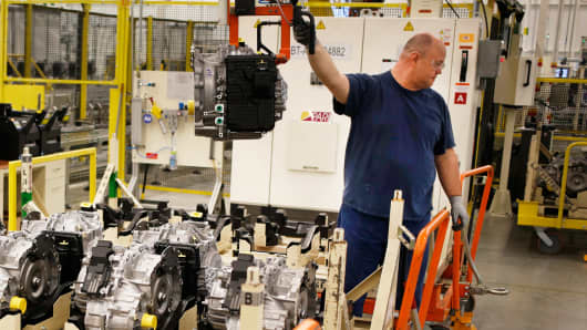 A factory worker moves finished transmissions for Chrysler vehicles at the company's Tipton Transmission Plant in Tipton, Indiana.