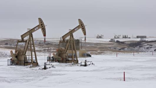 Pumpjacks operate at an oil well in Williston, North Dakota.