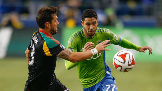 Lamar Neagle #27 of the Seattle Sounders FC battles Dan Gargan #33 of the Los Angeles Galaxy during the Western Conference Final last November in Seattle.