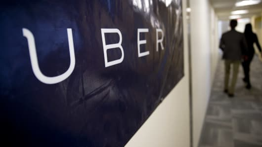 Uber Technologies signage hangs at a company office