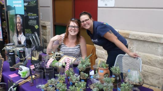 Claire Golubski, right, hosted a craft fair and outdoor concert at Whole Foods Austin to raise $2,000 for the foundation's microloan program.