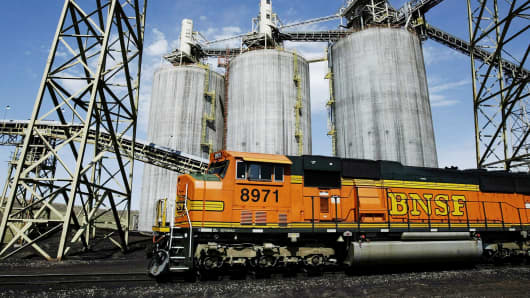 A Burlington Northern Santa Fe train moves through a coal-loading silo in Gillette, Wyoming