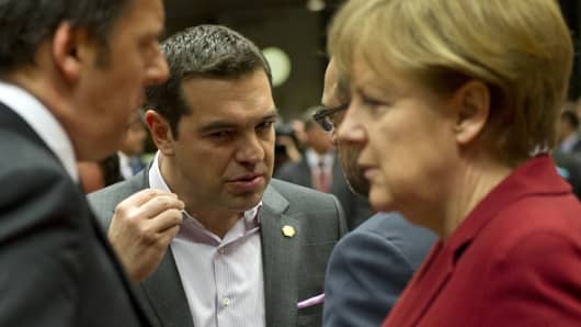 Italy's Prime minister Matteo Renzi, Greece's Prime minister Alexis Tsipras, European Parliament President Martin Schulz and Germany's Chancellor Angela Merkel talk.