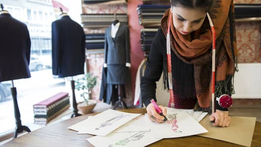 Fashion designer sketching in studio