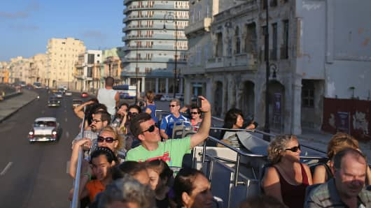 Tourists take in the sites from a tour bus in Havana, Feb. 28, 2015.