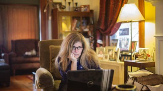 Emily Wittmann working from home in Montclair, New Jersey. Wittmann dipped into her retirement savings during the recent economic downturn and now is unsure when, if ever, she will be able to retire.