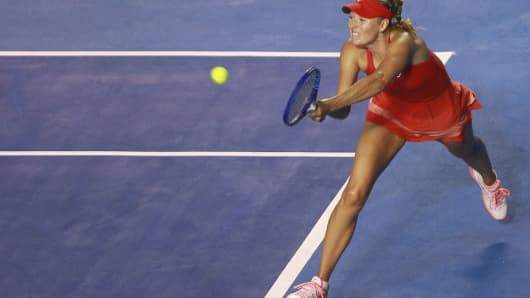 Maria Sharapova returns a shot during a women single match as part of Telcel Mexican Open 2015 at Mextenis Stadium on February 25, 2015