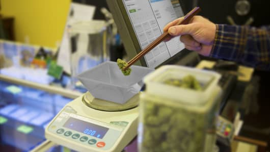 A marijuana bud is weighed in Colorado as the pot industry continues to grow.