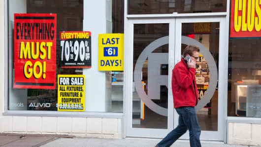 A pedestrian passes a Radio Shack store soon to be closed in New York.