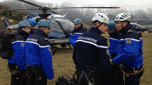 Gendarmerie and French mountain rescue teams arrive near the site of the Germanwings plane crash.