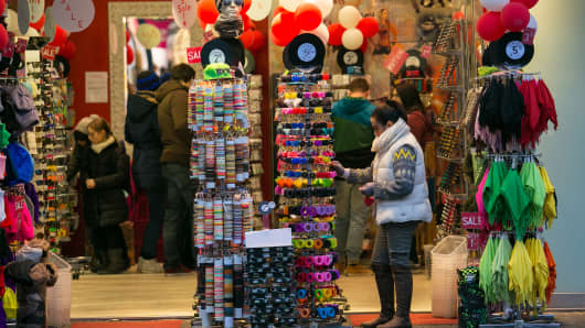 Shoppers browse items for sale inside a gift shop in Mannheim, Germany.