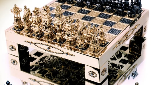 A gold chess set designed by Hugh Power
