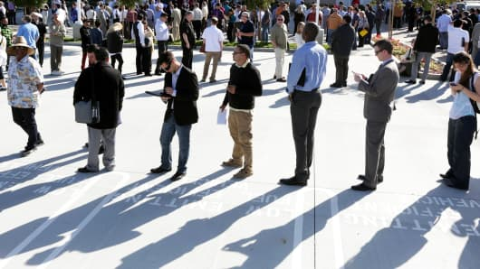 People line up for a job fair at a new Virgin Galactic and The Spaceship Company facility in Long Beach, California, March 7, 2015.