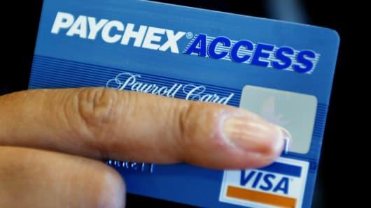 Reina Barrett holds her Paychex Access payroll card in Brookline, Mass.