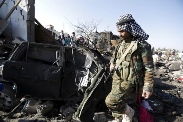 A Houthi fighter at the site of an air strike at a residential area near Sanaa Airport in Yemen, March 26, 2015.