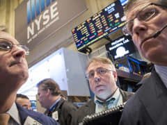 Traders on floor of New York Stock Exchange