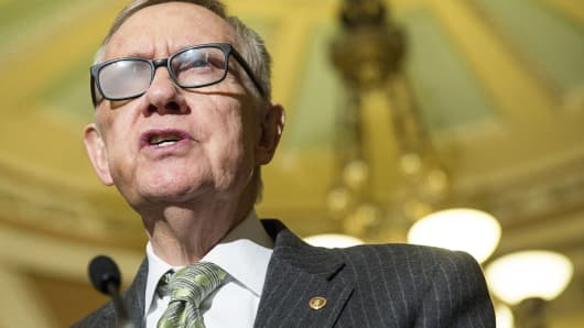 Sen. Harry Reid, D-Nevada, speaks during a press conference on Capitol Hill on March 17, 2015.