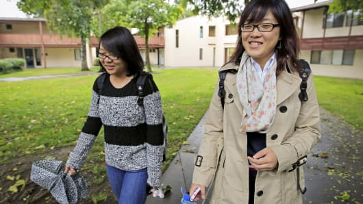 University of California, Davis freshmen Guan Wang, right, and Tracy Chen walk to class.