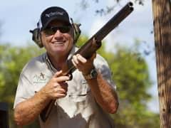 Nick Price holding shotgun
