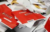 Red Netflix envelopes at post office