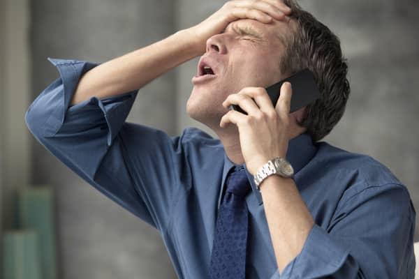 Businessman slapping forehead