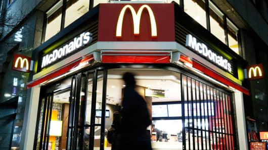 A pedestrian walks past a McDonald's restaurant in Tokyo.