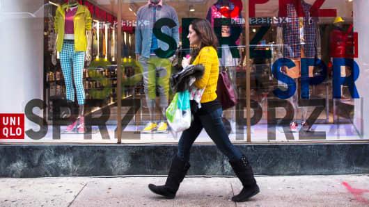 A shopper walks past a Uniqlo store in Philadelphia