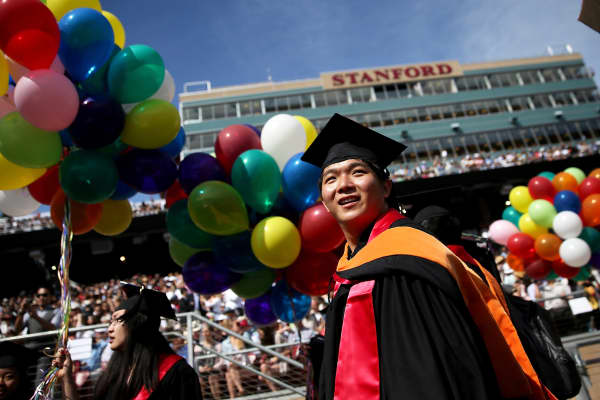 Graduating Stanford University students are shown before the start of the 123rd Stanford commencement ceremony, June 15, 2014, in Stanford, Calif.