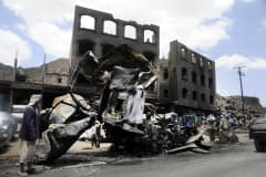A damaged car which was hit by Saudi-led Arab coalition forces to fight against Houthis, in Sanaa, Yemen, April 1, 2015.