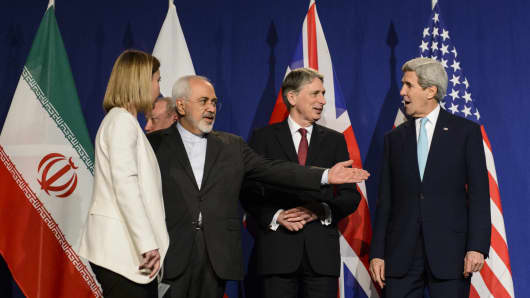 From left, EU High Representative for Foreign Affairs and Security Policy, Federica Mogherini, Iranian Foreign Minister, Mohammad Javad Zarif, British Foreign Secretary, Philip Hammond, and U.S. Secretary of State, John Kerry, line up for a press announcement after the end of a new round of Nuclear Iran Talks in the Learning Center at the Swiss federal Institute of Technology (EPFL), in Lausanne, Switzerland, Thursday, April 2, 2015.