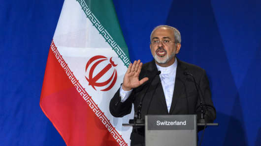 Iranian Foreign Minister Mohammad Javad Zarif gestures gestures as he speaks during a press conference at the Swiss Federal Institute of Technology in Lausanne (Ecole Polytechnique Federale De Lausanne) on April 2, 2015, after the announcement of an agreement on Iran nuclear talks.