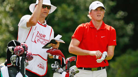 Russell Henley chats with caddy Adam Hayes on the eighth hole during the first round of the Tour Championship in Atlanta, Sept. 11, 2014.