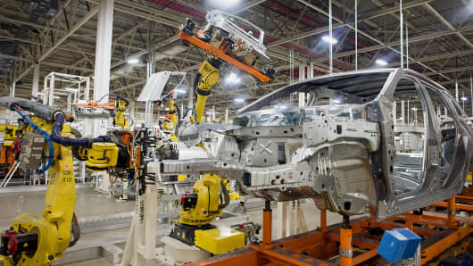 Robots work on the production line at the Chrysler Toledo Assembly Plant in Toledo, Ohio, Feb. 28, 2014.