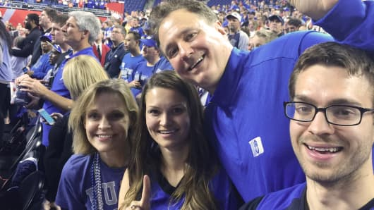 Steve Pagliuca and family cheer on Duke at the NCAA Men's Basketball National Championship game in Indianapolis on April 7, 2015.