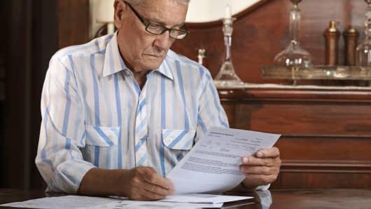 Senior man looking at paperwork