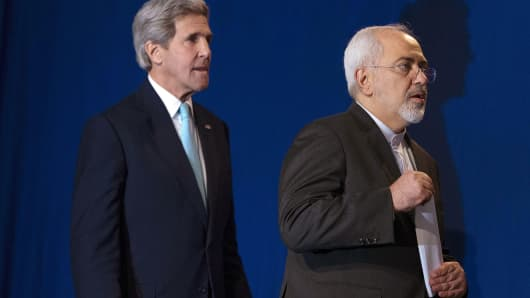 Secretary of State John Kerry (left) and Iranian Foreign Minister Javad Zarif arrive to deliver statements after nuclear talks in Lausanne, Switzerland, on April 2, 2015.