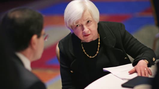 Federal Reserve Bank Board Chair Janet Yellen speaks with Division of Consumer and Community Affairs Director Eric Belsky during the ninth biennial Federal Reserve System Community Development Research conference in Washington.