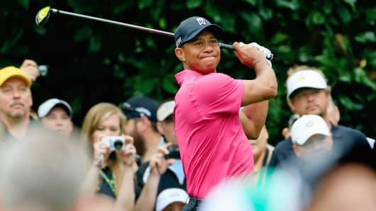 Tiger Woods watches a tee shot during a practice round prior to the start of the 2015 Masters Tournament at Augusta National Golf Club, April 7, 2015, in Augusta, Ga.