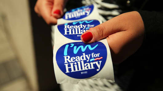 Stickers are handed out to supporters of Hillary Rodham Clinton's presidential campaign at a rally on April 11, 2015 in New York City.